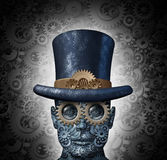 Steampunk Science Fiction. Concept as a fantasy mechanical human head made of gears and cogs wearing a historical victorian retro top hat as a technology symbol Royalty Free Stock Photos