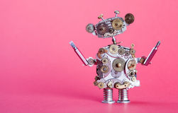Steampunk service robot concept. Repair man with screw drivers. Aged gears, cog wheel hand clock parts mechanism. Shabby Royalty Free Stock Image