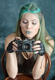 Steampunk-styled girl experiments with old camera Stock Photography