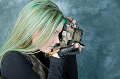 Steampunk-styled Girl Experiments With Old Camera Royalty Free Stock Images