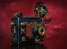 Steampunk su un fondo rosso fotografie stock