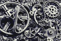 Steampunk texture, backgroung with mechanical parts, gear wheels. Steam punk cogwheels, heap of auto parts, old rusty iron chains, springs, wheels, close up stock photos
