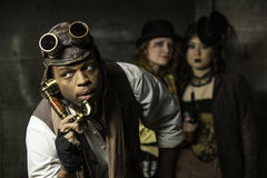 Steampunk Trio. Steam Punks in Underground Lair with Retro Phone Stock Image