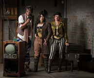 Steampunk Trio. Three Young Diverse Steampunks in Retro Lair Stock Photo