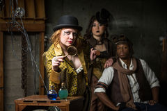 Steampunk Trio with In Retro Lab Royalty Free Stock Photo