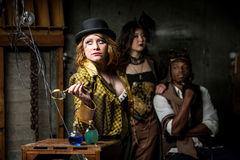 Steampunk Trio with In Retro Lab Royalty Free Stock Image