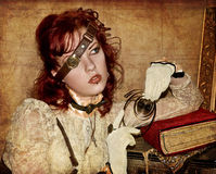Steampunk Victorian Girl. With red hair and red lips Royalty Free Stock Photo