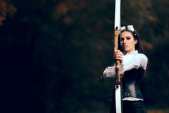 Female Archer Warrior in Costume with Bow and Arrow. Steampunk warrior princess hunting in nature Royalty Free Stock Photo