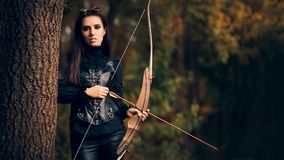 Female Archer Warrior in Costume with Bow and Arrow. Steampunk warrior princess hunting in nature Stock Image