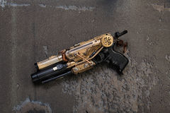 Steampunk weapon golden. Weapon in steampunk look individual production with gold elements Royalty Free Stock Photo