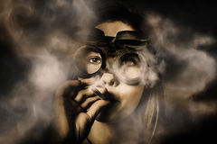 Steampunk welder smoking cigarette Royalty Free Stock Photography