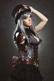 Steampunk woman aiming with gun Royalty Free Stock Photos