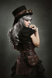 Steampunk woman back. Texture background stock photo