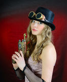 Steampunk woman with gun. Steampunk Woman With Pistol , Top Hat And Goggles Stock Photo