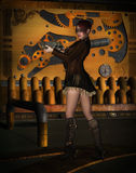 Steampunk woman. With gun and steampunk background Royalty Free Stock Photography