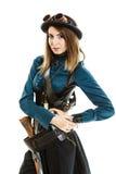 Steampunk woman with gun studio shot. Royalty Free Stock Image