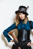 Steampunk woman with gun studio shot. Stock Photos