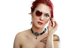Steampunk woman. Portrait of beautiful redhead steampunk woman wearing glasses posing next to color background stock photos
