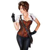 Steampunk woman wearing vintage corset and retro goggles. Portrait of a beautiful steampunk woman wearing vintage corset and retro goggles royalty free stock photo