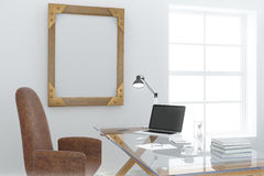 Steampunk wooden picture frame in modern light office room with Stock Image