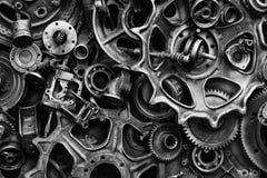 Steampunkachtergrond, machine en mechanische gedeelten, grote toestellen en kettingen van machines en tractoren stock fotografie