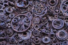 Steampunkachtergrond, machinedelen, grote toestellen en kettingen van machines en tractoren stock afbeeldingen