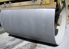 Steamroller flatten out the asphalt. Stock Photos