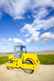 Steamroller on highway construction Stock Photo