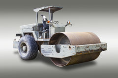 Steamroller isolated with clipping path. Steamroller isolated on gray background with clipping path Royalty Free Stock Images
