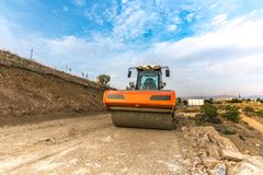 Steamroller performing work prior to the asphalting of a road. In Spain royalty free stock photography
