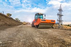 Steamroller performing work prior to the asphalting of a road in Spain. Steamroller performing work prior to the asphalting of a road royalty free stock image