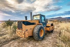 Steamroller performing work prior to the asphalting of a road. In Spain royalty free stock photo