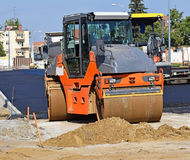 Steamroller works at the road construction Royalty Free Stock Photo