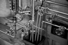Steamship boiler and valves Stock Images