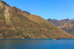 Steamship sailing in front of the mountains in Queenstown, New Z Stock Photography