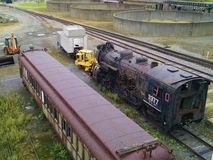 Locomotive engine and passenger cars out in elements stock image