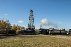 Wooden Drilling Rig with a passing steamtrain stock photography