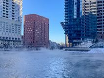Steamy Chicago River during winter temperature plunge. Steamy Chicago River in Chicago Loop during winter temperature plunge in January royalty free stock image