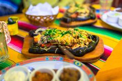 Plate of mexican chicken fajitas. Steamy hot mexican beef and chicken fajitas Royalty Free Stock Images