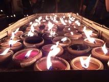 Stearinljus budhisttempel Chiang Mai arkivfoton