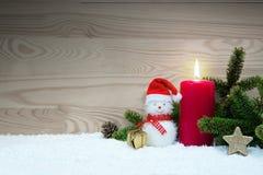 Stearinljus för jul snögubbe och Advent klaus santa för frost för påsekortjul sky Arkivfoto