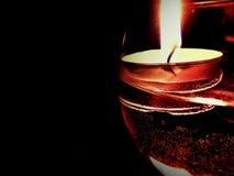 Stearinljus i exponeringsglas Arkivfoto