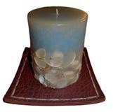 Stearinljus i grunden som isoleras på vit Royaltyfria Bilder
