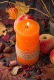 Stearinljus- och höstsidor Royaltyfri Foto
