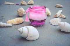 Stearinljus och skal Fotografering för Bildbyråer