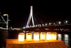 Stearinljus och stadspanorama Arkivfoto