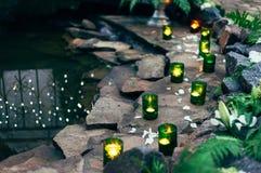 Stearinljus och vatten Arkivbild
