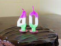 40 stearinljus på chokladfödelsedagkakan Royaltyfria Foton