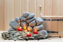 Stearinljus, stenar för bastu och bad Royaltyfri Foto