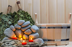 Stearinljus, stenar för bastu och bad Arkivbilder